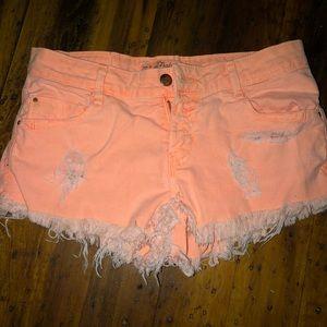 Distressed peach jean shorts